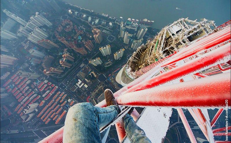 Crazy Ivan climbs atop the frozen crane of the 2073-foot Shanghai Tower