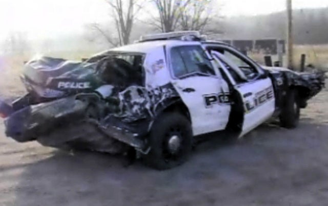 Train hits police cruiser during chase, suspect gets away