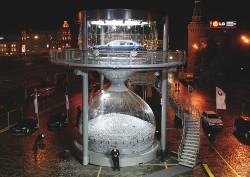 World's Largest Hourglass Filled With Silver Balls and a Luxury Sedan For BMW Moscow Launch