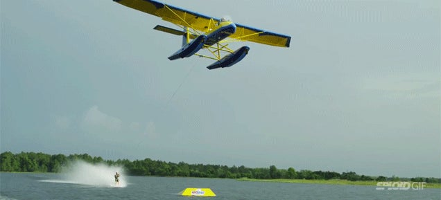 Watch these lunatics water ski barefoot towed by a freaking airplane