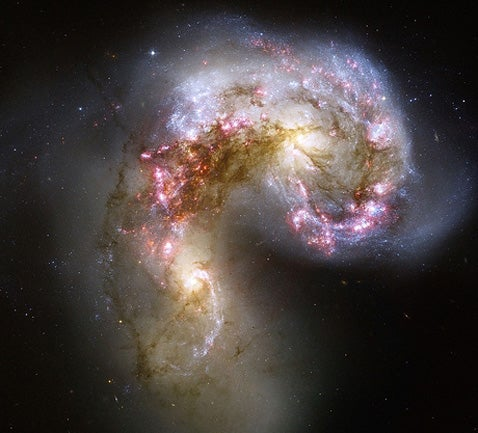 When Galaxies Collide! And Then Eat Each Other!
