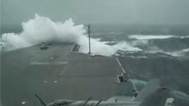 Watch Giant Waves Crash Over The Bow Of A U.S. Super Carrier