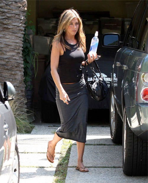 Celebrity Spokeswoman Jennifer Aniston Has Her Bottle Held Aloft