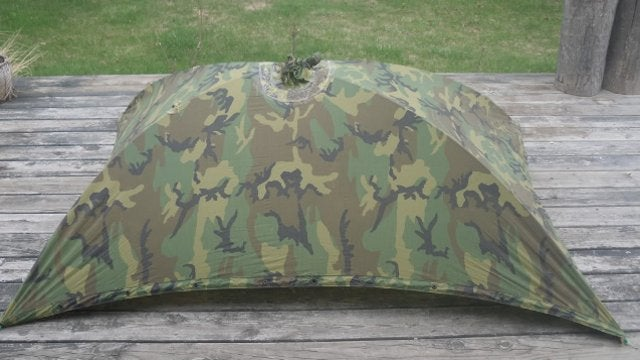 Utilize a Military Poncho as a Backpacking Tarp with Collapsible Tent Poles