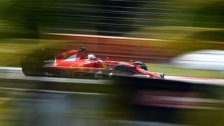 [F1's weekend in Malaysia is underway. Here's Sebastian Vettel wheeling his Ferrari in the sun. Photo Credit: Getty Images]