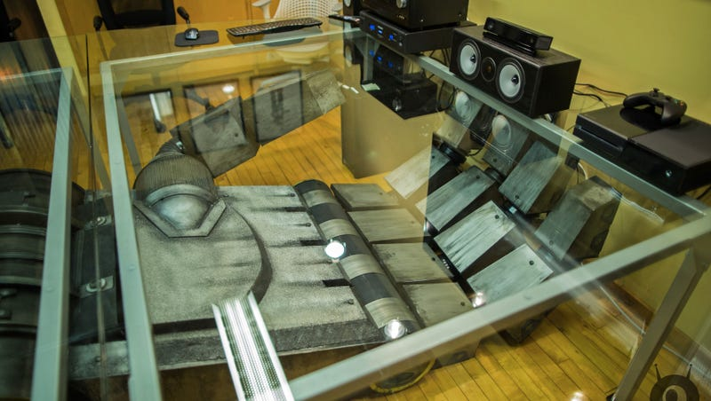 Every Office Needs a Giant Severed Robot Hand Conference Table