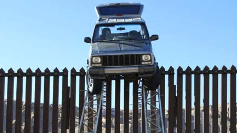 The U.S. Border Patrol Found This Jeep Stuck On Top Of The Border Fence