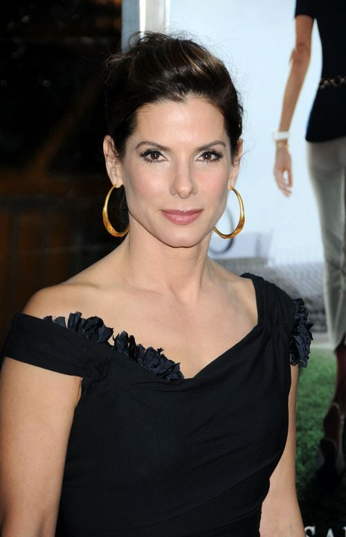 Sandra Bullock Photo Starts Bidding War; Baios' Behavior Makes The News
