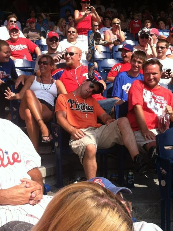 Let's Play Stack The Cans On The Passed-Out Phillies Fan