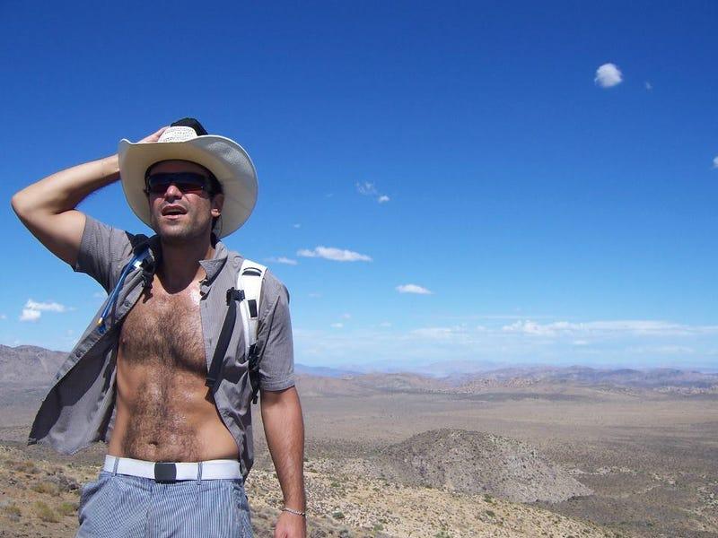 Intrepid Reporter Climbs Hill, Unbuttons Shirt, Gazes Into Distance
