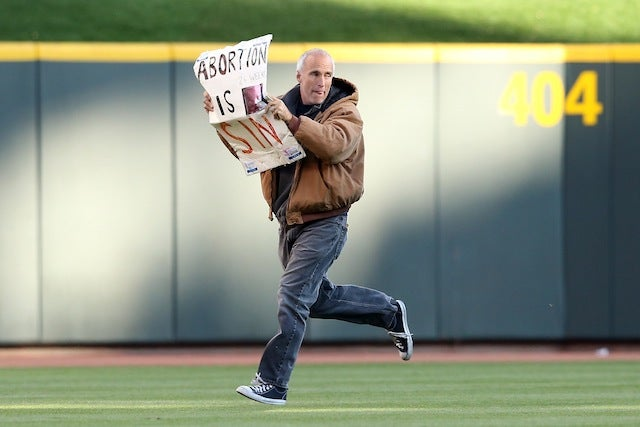 Tonight's Giants-Reds NLDS Game Was Delayed By A Fan Who Ran Onto The Field With A Mitt Romney Sign [UPDATE]