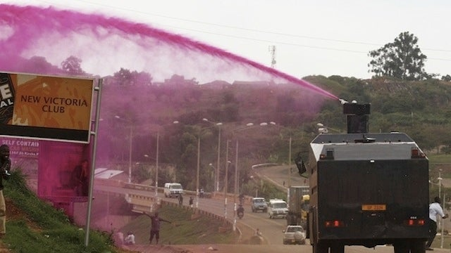 Ugandan Police Sprayed People with Pink Water Cannons to Break Up a Ceremony