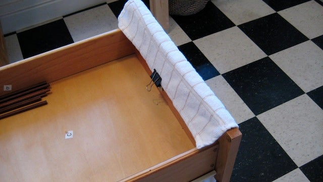 Mount a Binder Clip in Your Kitchen Drawer to Hold Towels