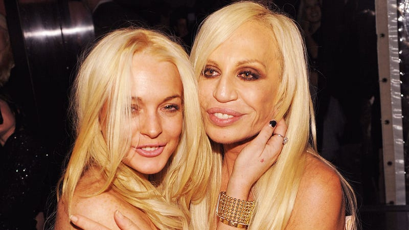 Lindsay Lohan Snuggles With Her Own Terrible Super-Tan Future