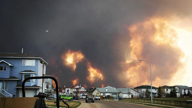 Thousands of Homes Destroyed as Wildfires Continue to Ravage Canadian Oil Town