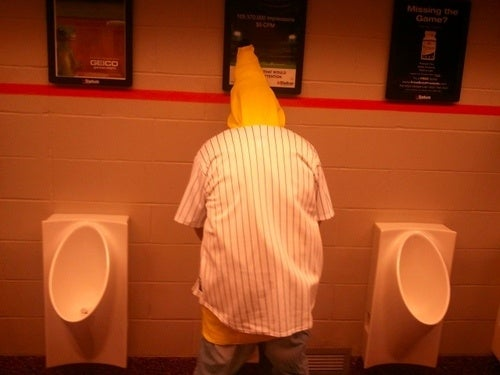Man In A Banana Suit Using A Citi Field Urinal? Man In A Banana Suit Using A Citi Field Urinal.