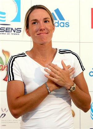 Justine Henin Retires • Basket-Weaving Brings Women Together
