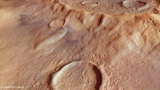 Stunning New Close-Ups Of The Largest Crater On Mars