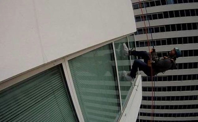 Locked-Out Hockey Player Scales Tall Building