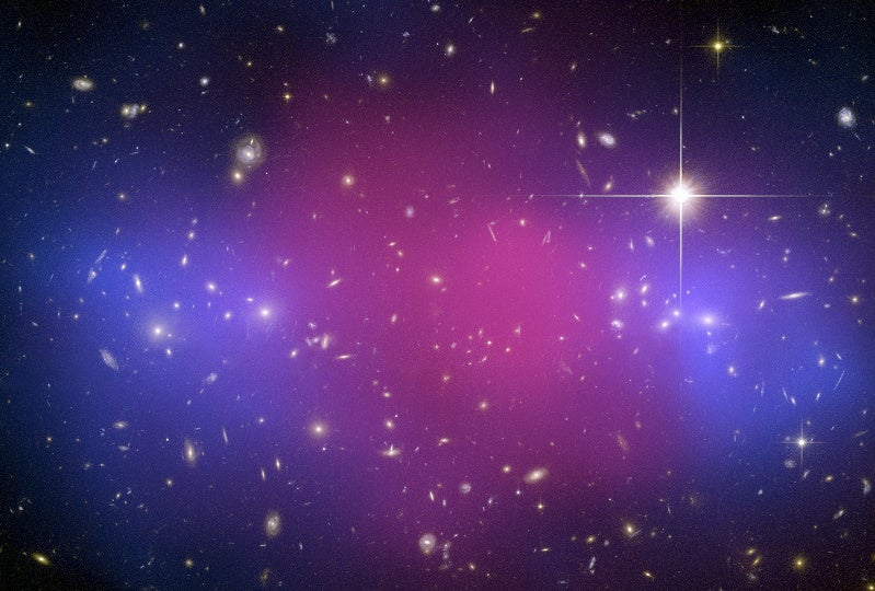 Galactic Cluster Collision Divides Ordinary Matter from Dark Matter