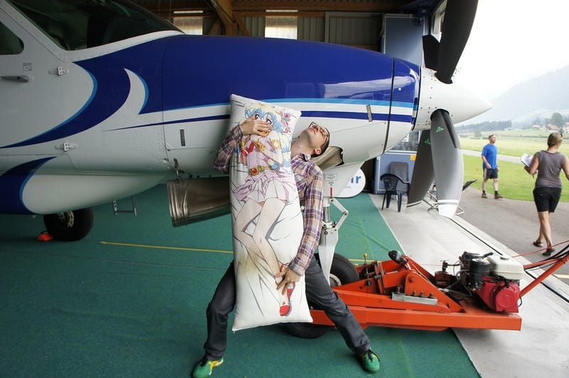 Pure Nerd Insanity: Two Men Skydiving with a Girly Hug Pillow
