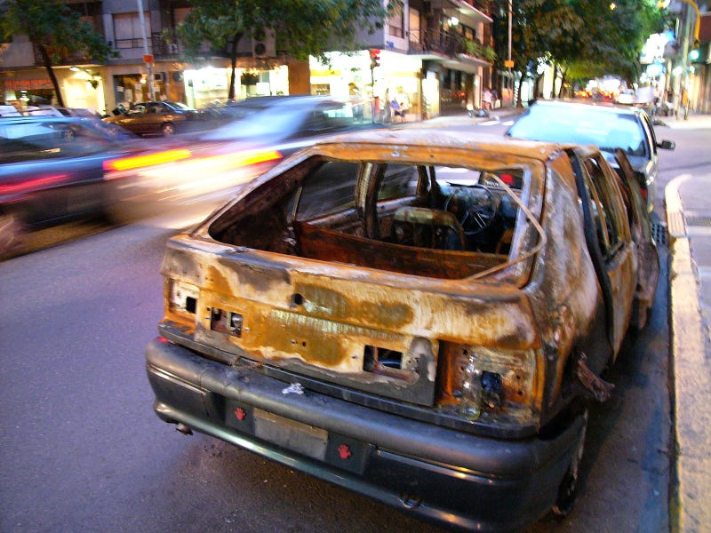 A Burned-Out Wreck Spices Up A Posh Neighborhood