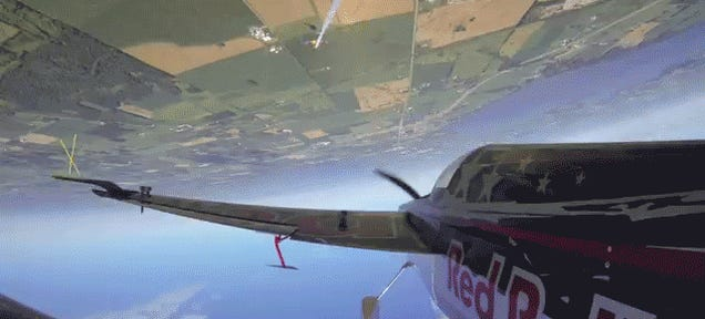 Watch A Stunt Plane Do A Roll Around Another Plane