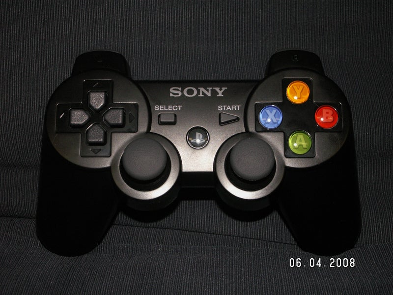 An Xbox 360 Controller Crammed into a PS3 Dual Shock Controller's Body