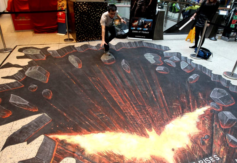 Dark Knight art appears to rip the floor out of an Australian mall