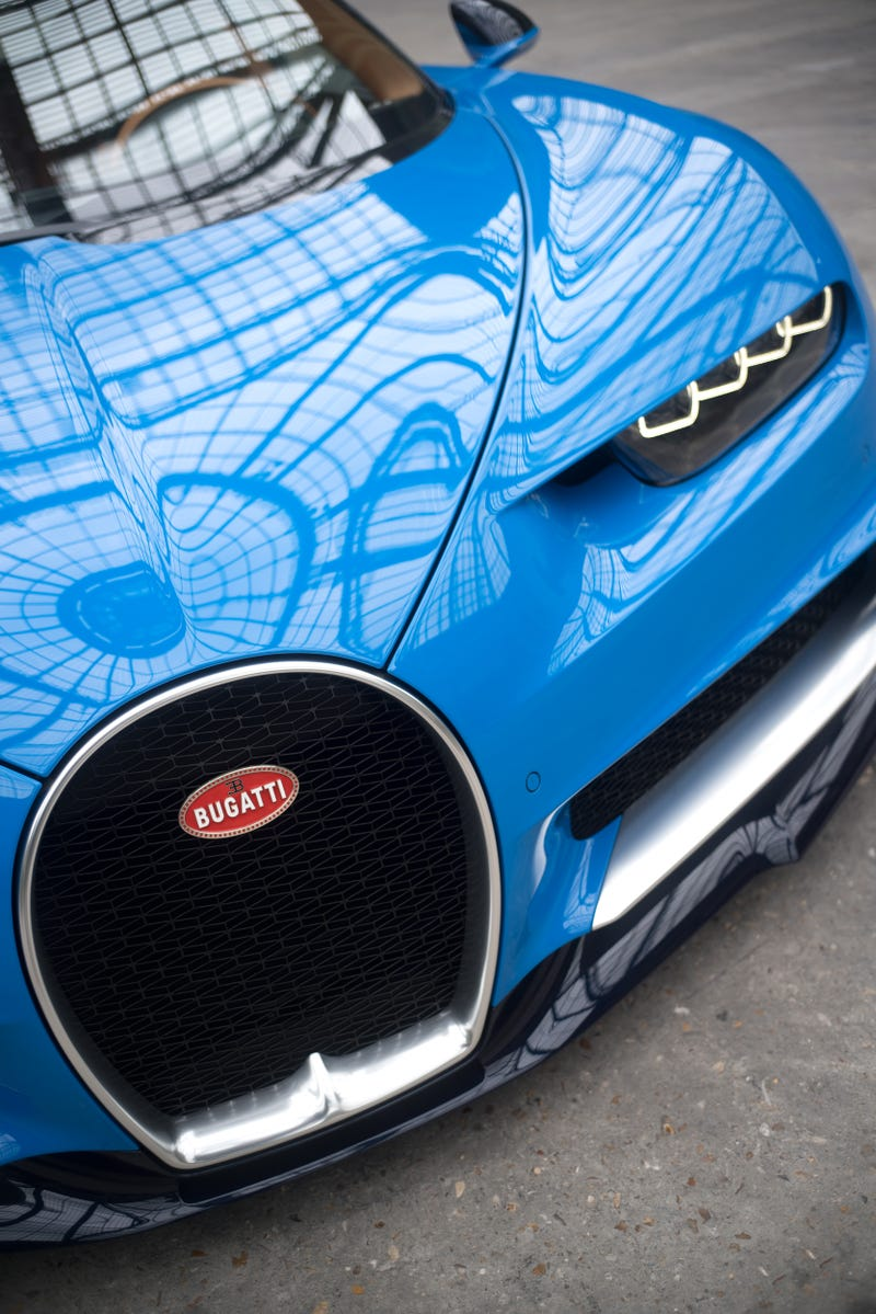'Bugatti Chiron: This Is A Lot More Of It ' from the web at 'http://i.kinja-img.com/gawker-media/image/upload/s--y2QhImVS--/c_scale,fl_progressive,q_80,w_800/riqf7c19iprpdzbmdh19.jpg'