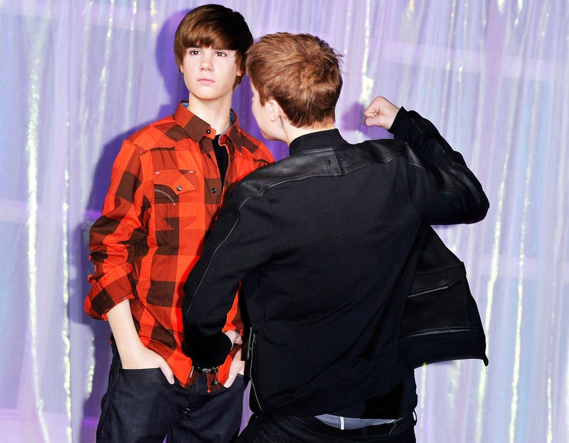 Horrifying Pictures of Children Interacting with Bieber's Wax Statue