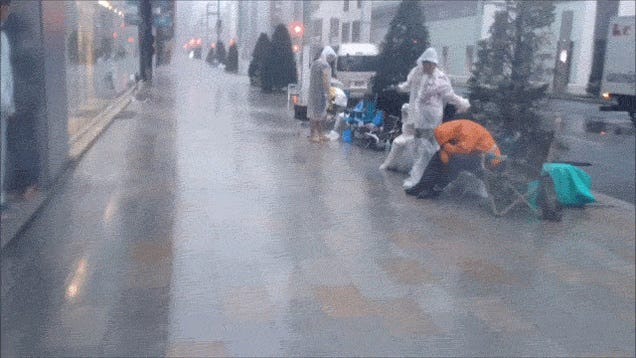 Apple Customers Escape Japanese Typhoon in Apple Store