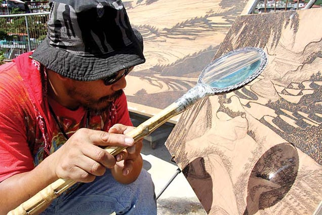 This Artist Uses His Magnifying Glass To Burn Art, Not Ants