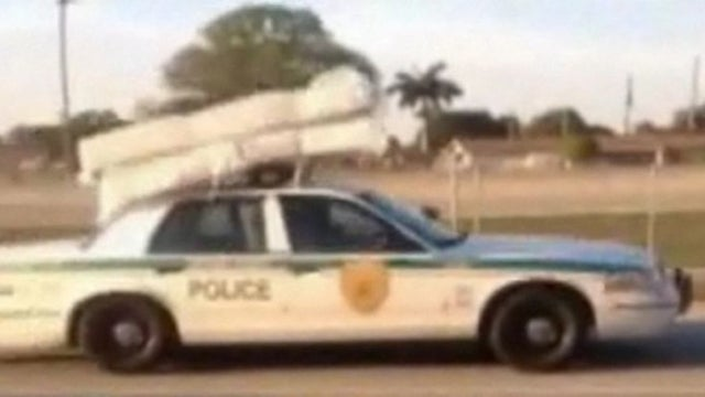 Florida Cop Transports Mattress, Box Spring With Squad Car