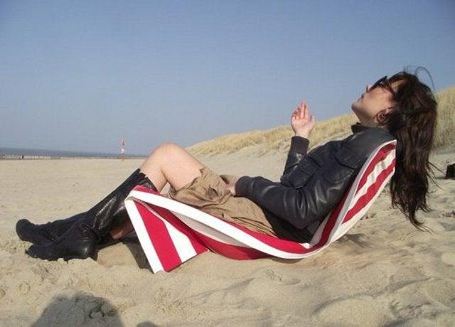 Repurpose a Beach Towel and Broomsticks Into a Beach Chair