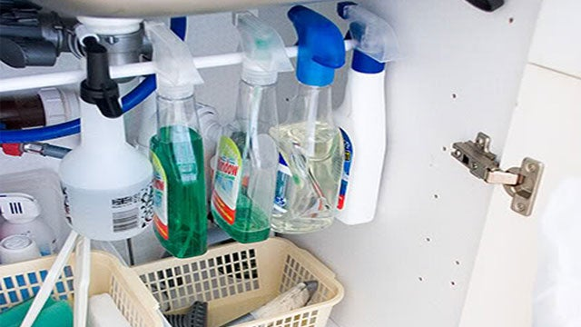 Organize Cleaning Bottles Under the Sink with a Tension Rod