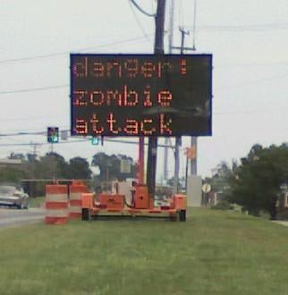 Jalopnik-Hacked Road Sign: We're All Going To Jail Now