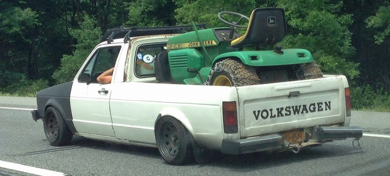 This VW Caddy Carrying A Tractor Just Might Make You Like 'Stanced' Cars