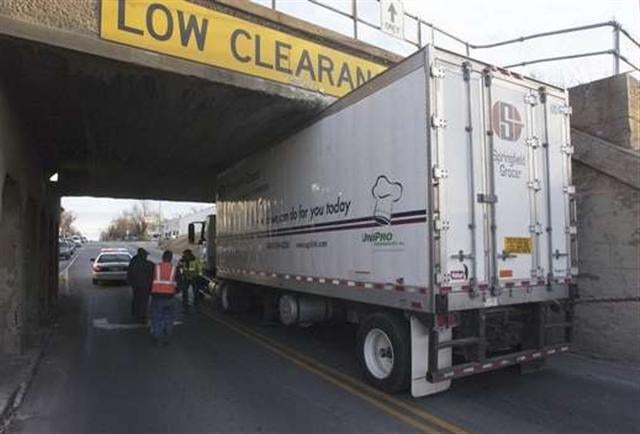 Missouri Truck Driver Doesn't Read Jalopnik, Gets Stuck Under Bridge
