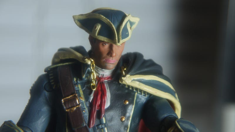 I'm Playing Assassin's Creed IV Right Now. On My Desk. With Toys.