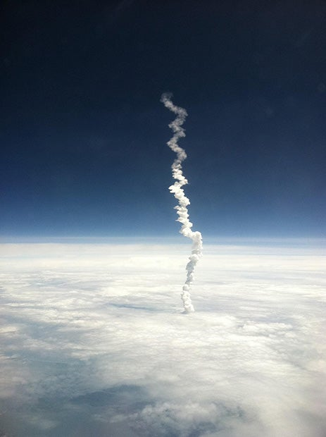 The last launch of NASA's Space Shuttle program, caught from an airplane