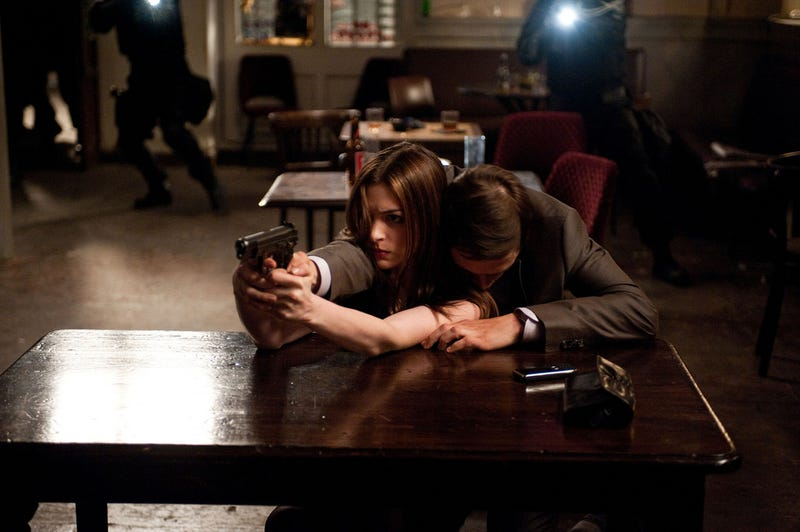 Brand new Dark Knight Rises photos show Catwoman using a dead body as a human shield