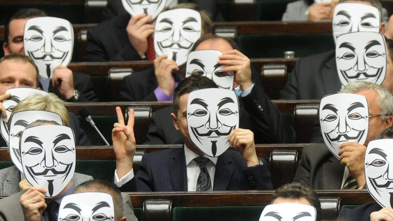 Polish Politicians Don Anonymous Masks To Protest EU Counterfeiting Agreement
