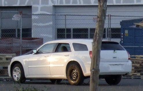 Tesla Whitestar Sedan Powertrain Mule Caught Lurking About, Wearing Dodge Magnum Skin