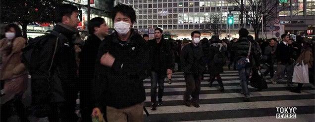 Surreal reversed footage of a man walking backwards in Tokyo