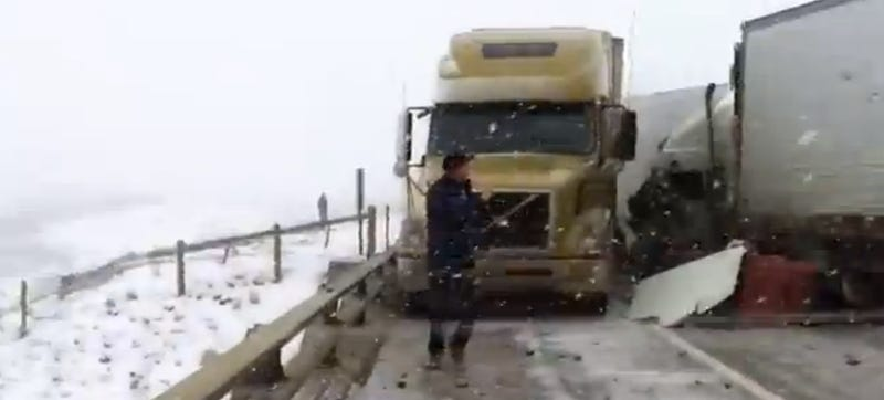 Trucker Freaks Out As Big Rigs Crash In Slow-Motion On An Icy Highway