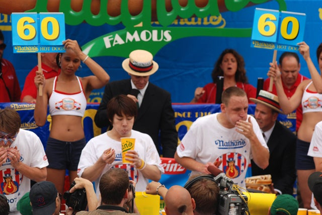 Hot Dog Eating Champion Gets Engaged Before Winning Eighth Contest