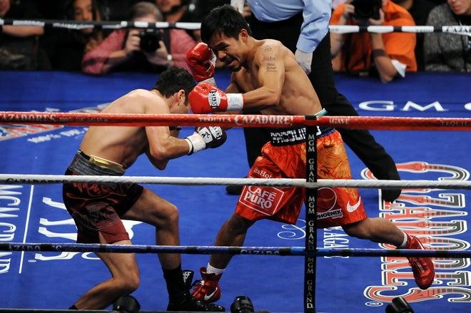 Pacman Destroys A Listless De La Hoya
