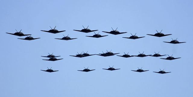 This swarming horde of black stealth fighter jets is not a movie scene