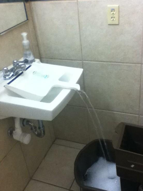 Use a dustpan to fill containers that don t fit in your sink